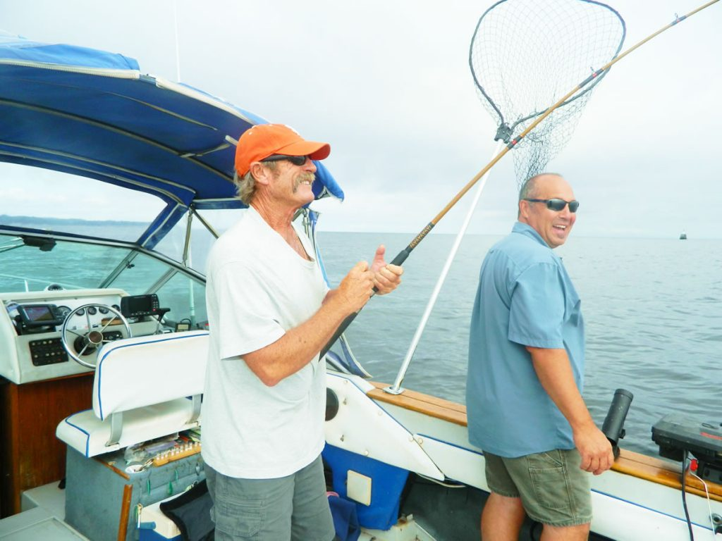 Captain Bob and Jimmy fishing with Tom Davis.